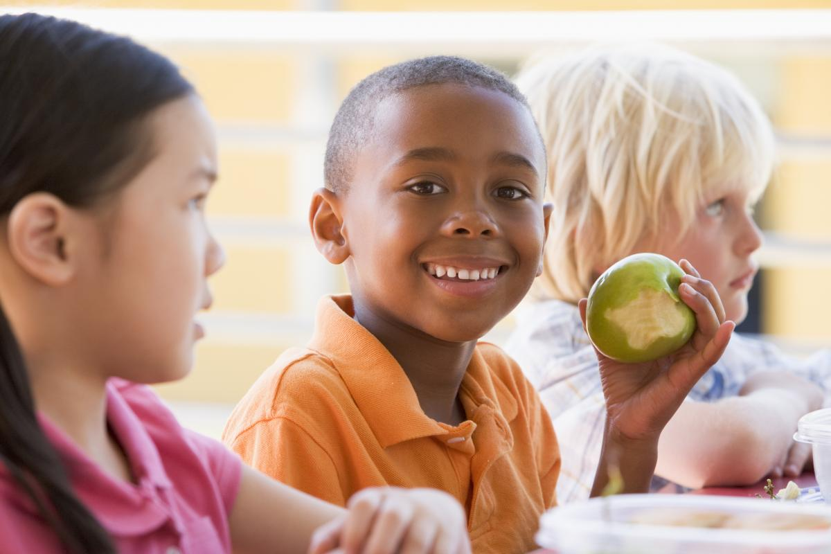Image of child eating an apple