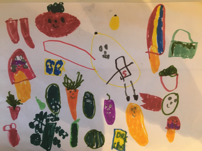 Nico drew a lovely array of smiling fruit and vegetables with a flying, healthy superhero in the centre
