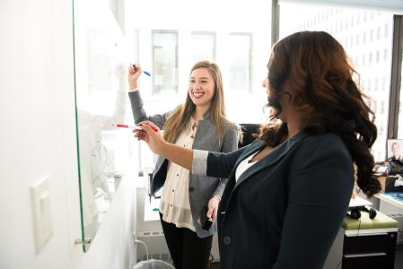 Image of women at a whiteboard