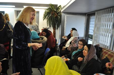 A photograph of one of the speaker events. The speaker talks to clients attending the centre