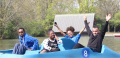 A photo of four young people having fun in a boat.