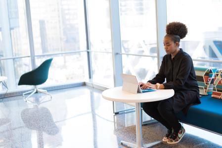 Image of a woman at a computer