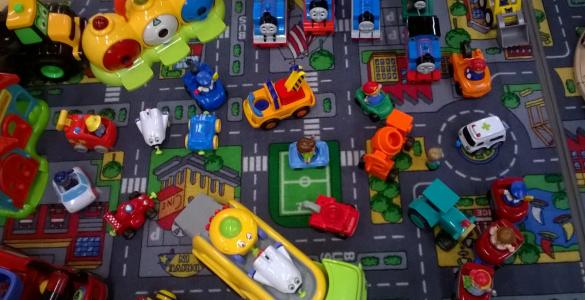 Photo of the toys cars on a cityscape mat
