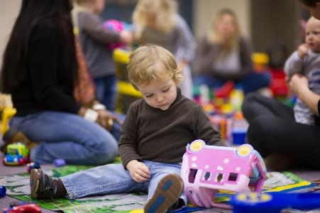 Image of child playing in a playgroup