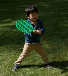 A child playing tennis