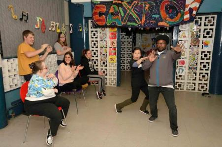 Members of Caxton Youth Organisation taking part in a drama activity.