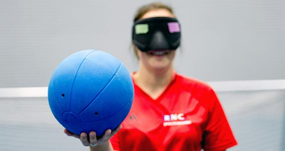 Image of a young blind person with a ball