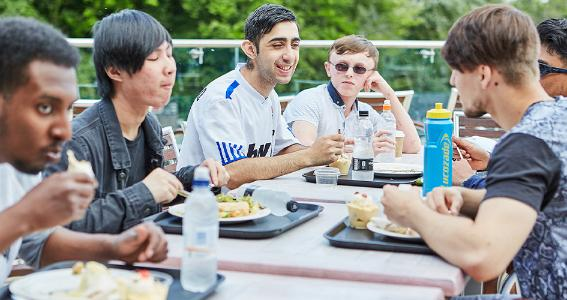 Image of visually impaired young people having lunch