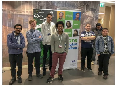 A photo of some of the participants in the 2019-2020 Supported Internship programme smiling beside an RBKc poster.