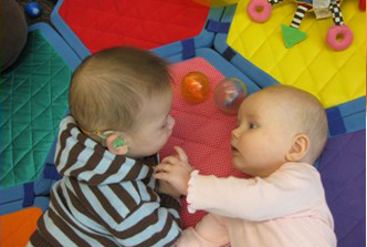 WSS Baby Group photo. Two babies playing together.