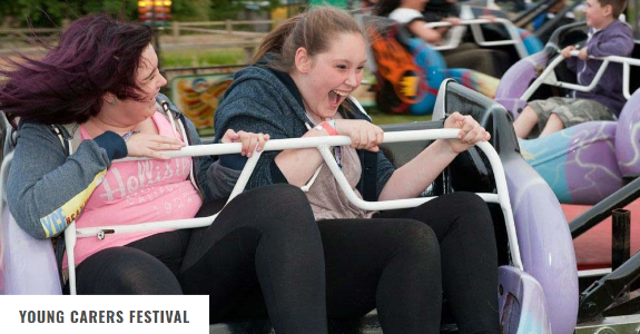 A photo of two young carers enjoying a ride at the Young Carer's Festival