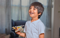 Smiling child with a plane