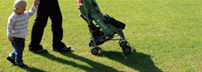 child walking on the grass
