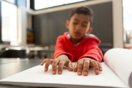 Boy Reading Braille