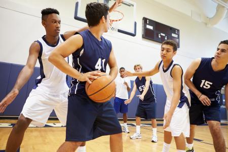 Boys Playing Basketball As A Team
