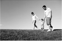 Family walking on grass image