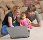Family looking at a computer image