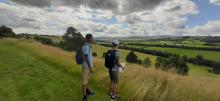 Young people on an event on site - looking over the Lowther valley