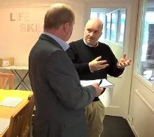 R2W Regional Manager Pete Bradbury giving a tour of the 'Life Skills' area at R2W HQ