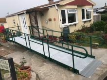 Photo of a mobile home with a wheelchair ramp