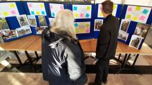 Learner Robert looking at his project work on display at Lowther