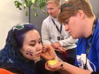 ETF staff and learners facepainting on a charity day for MIND