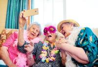 Ladies dressed up taking a selfie