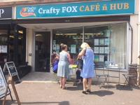 Customers outside the Crafty Fox cafe