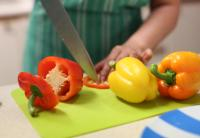Person cutting vegetables