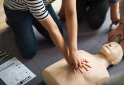 Hands pumping first aid dummy