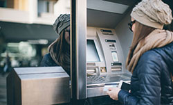 Young person at cash machine