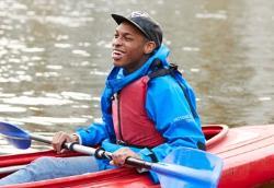 Kayaking instructor in boat