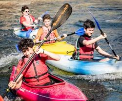 Children paddling in kayaks