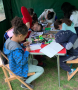 Children at table drawing
