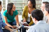 Adults discussing at library
