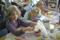Children around a table taking part in craft activities
