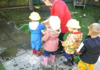 The children role playing being a fire fighter and putting out chalk flames.