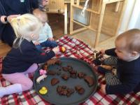 Baby room messy play with cake
