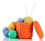 Basket of wool and knitting needles.