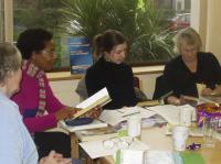 Adults reading at a table