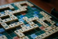 A scrabble board with tiles