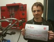 one of our trainees with the certificate they earned on completing the introductory course