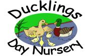 Day nursery logo; 2 ducks and 4 ducklings on the water