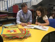 Coram Beanstalk reading helper with child