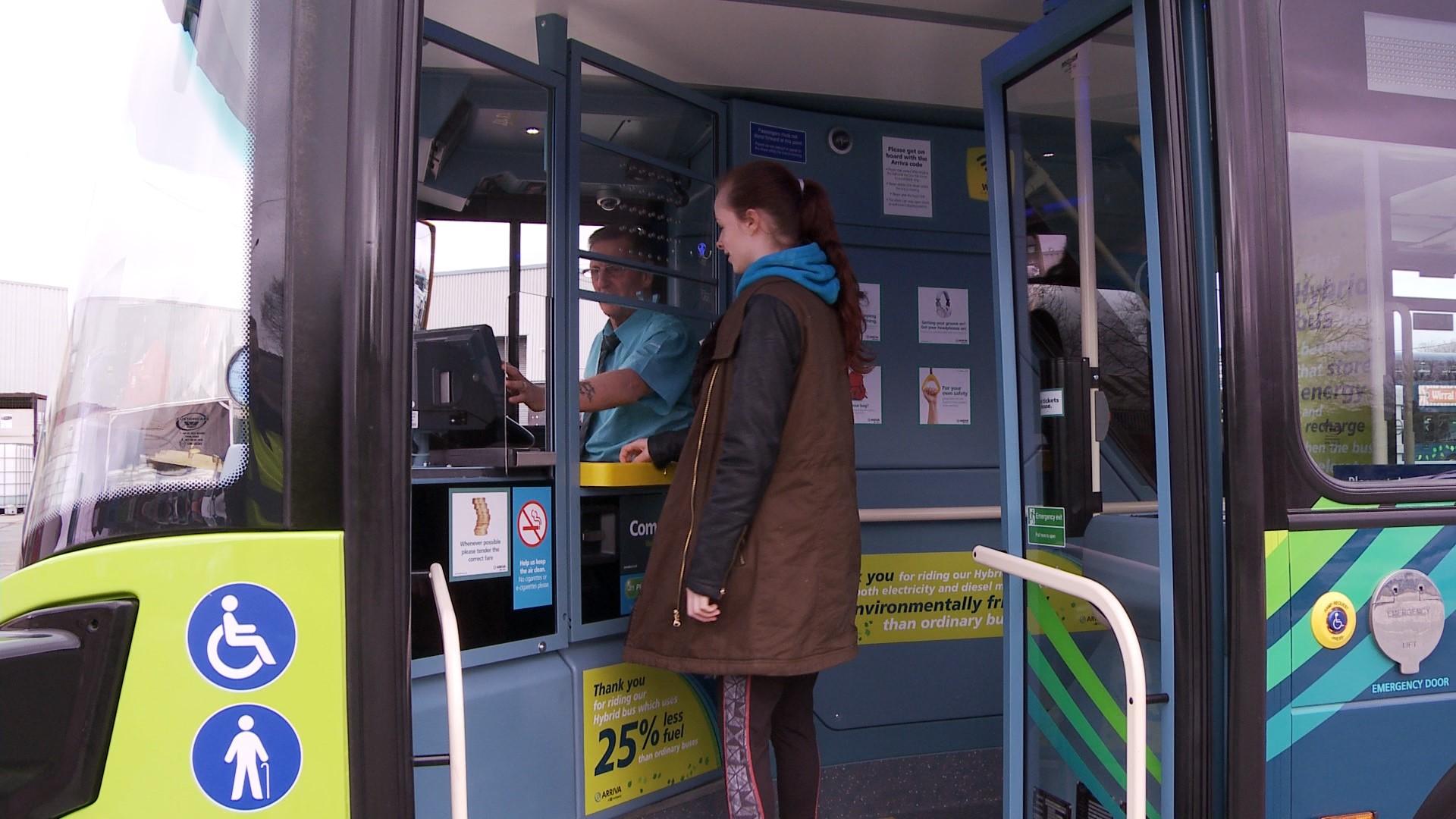 Courtney boarding a bus