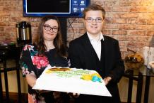 Melissa and Mark, graduating supported interns with the celebration cake