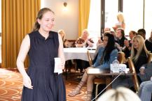Saoirse, a supported intern from Abbot's Leas school based at Amey PLC, leaving the stage after describing her experience.