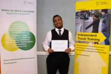 Adam from Sandfield Park School with his independent travel training certificate.