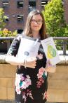 Melissa, supported intern from Greenbank College, with her graduation certificates and City and Guilds Experience in Hospitality Award.