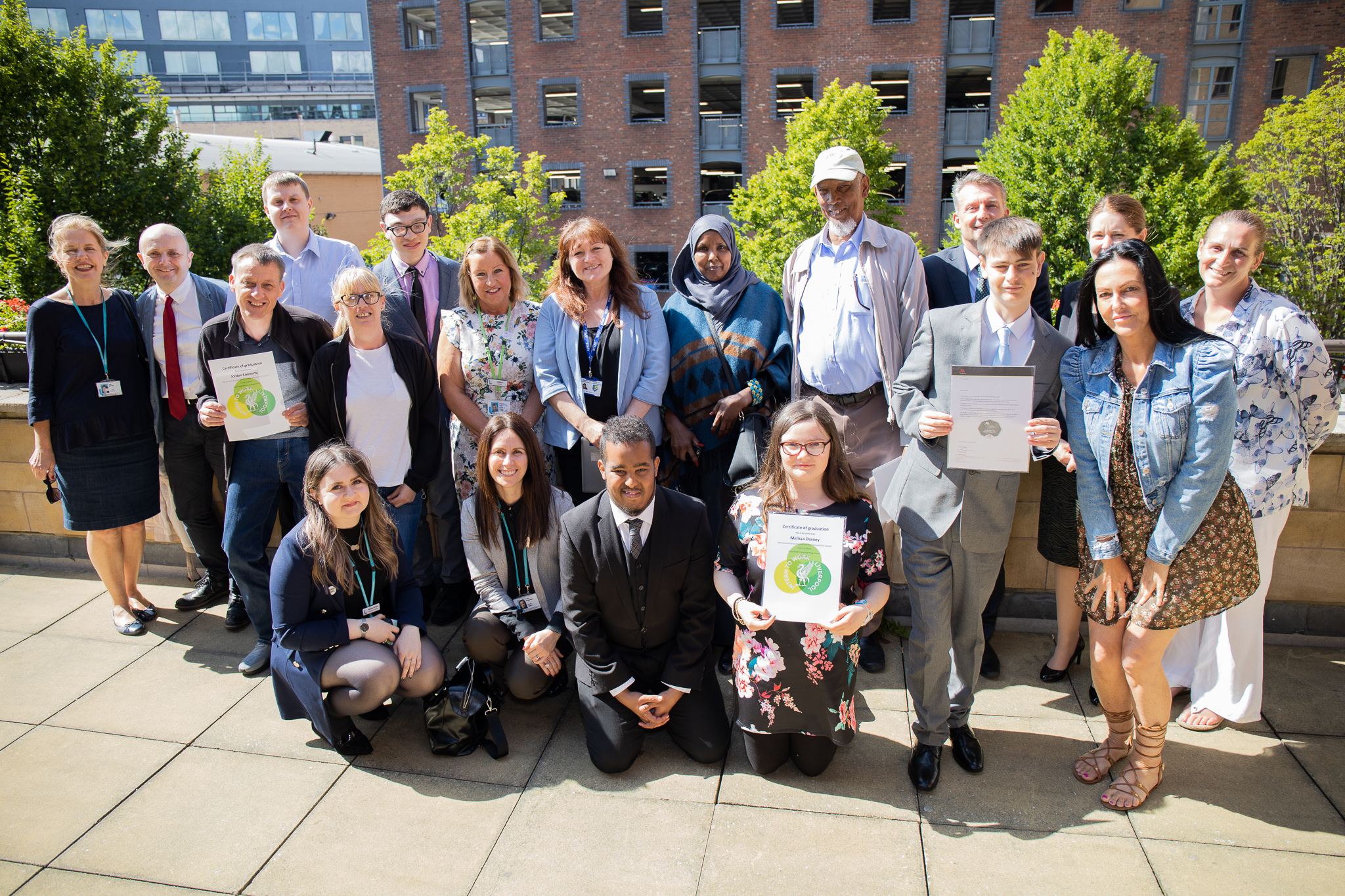Group shot of supported interns, their families, staff from host employers and education providers.